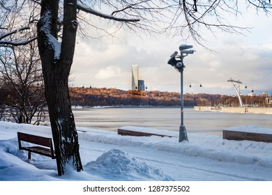 Moscow / Russia - january 15 2018:  Funicular. Skyscraper on background and the cabins of funicular. River with blue sky. Clouds. Copy space and free soace for text