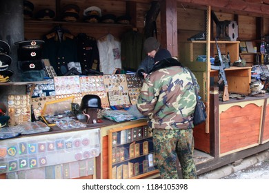 Moscow, Russia - January 15th 2011: Military artefacts, including a Kalashnikov AK 47, for sale at the Izmailovsky Market in Moscow