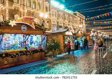 MOSCOW, RUSSIA - January 17, 2017: Christmas and New year's fair on Red square. Colorful decoration. Trade stall with Russian national costumes and Souvenirs