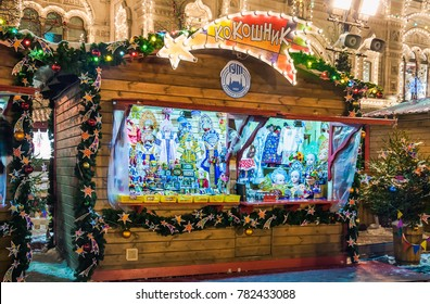 "MOSCOW, RUSSIA - January 17, 2017: Christmas and New year's fair on Red square. Colorful decoration. Trade stall ""Kokoshnik"" with Russian national costumes and Souvenirs"