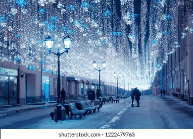 Moscow, Russia, January 17, 2018. Night winter Moscow in the snow. Nikolskaya street decorated for the New year. Unidentified people walking on the street.