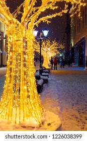 Moscow, Russia, January 17, 2018. Night winter Moscow in the snow. Street  decorated for the New year. Unidentified people walking on the street.