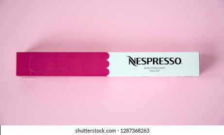MOSCOW, RUSSIA - JANUARY 17, 2019: Limited Collection Nespresso Variations Paris Coffee Capsules Box on Pink Background. Coffee Blend Praline. Nespresso is Worldwide Company of Coffee Products.
