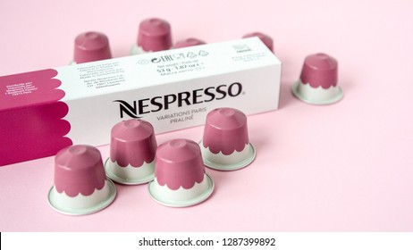 MOSCOW, RUSSIA - JANUARY 17, 2019: Limited Collection Nespresso Variations Paris Coffee Capsules on Pink Background. Coffee Blend Praline. Nespresso is Worldwide Company of Coffee Products.