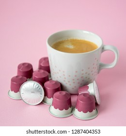 MOSCOW, RUSSIA - JANUARY 17, 2019: Cup of Coffee Nespresso Capsule on Pink Background. Limited Collection Variations Paris Coffee Blend Praline. Nespresso is Worldwide Company of Coffee Products.