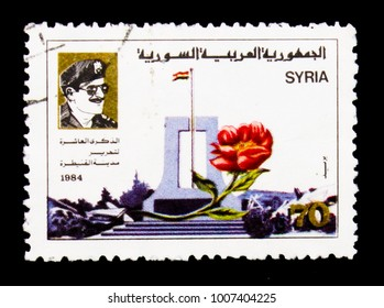 MOSCOW, RUSSIA - JANUARY 2, 2018: A stamp printed in Syria shows President Hafez al Assad,Al-Kuneitra Memorial serie, circa 1985
