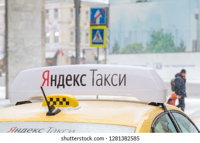 MOSCOW, RUSSIA - JANUARY 2, 2019: Close up sign of Yandex taxi in Moscow during winter season