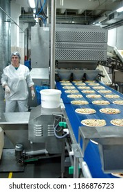 MOSCOW, RUSSIA - JANUARY , 2012: The conveyor from pizza. Factory of bakery products in Moscow.