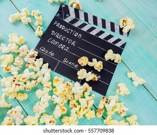 MOSCOW, RUSSIA - JANUARY 2017: Clapperboard and popcorn concept the film industry, movie, film, Golden globe and Oscar as the substrate