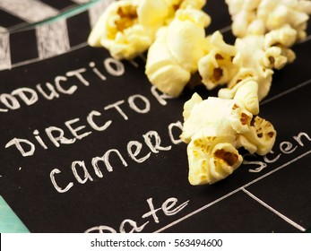 MOSCOW, RUSSIA - JANUARY 2017: Clapperboard and popcorn concept the film industry, movie, film, Golden globe and Oscar as the substrate, illustrative editorial.