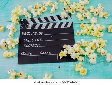 MOSCOW, RUSSIA - JANUARY 2017: Clapperboard and popcorn concept the film industry, movie, film, Golden globe and Oscar as the substrate, illustrative editorial