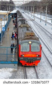MOSCOW, RUSSIA - JANUARY, 2017: The train on the platform, people sit in the cars, winter day.