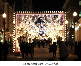 Moscow, Russia - January 2018: Festive decoration of the city, Christmas and New Year's lights, 2018. Night decoration of pedestrian street Arbat, Old Arbat