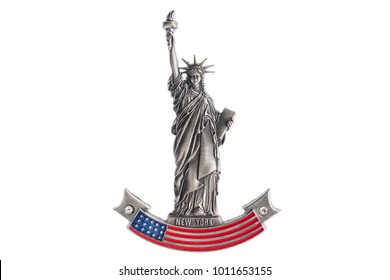 MOSCOW, RUSSIA - JANUARY, 2018: New York Statue of Liberty refrigerator magnet isolated on white background. Magnets are popular souvenirs.