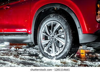 Moscow, Russia - January 2019 - Hyundai brand sports rim and tires Kumho on the stand, winter time, snow and ice.