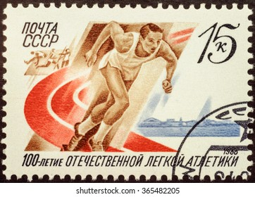 MOSCOW, RUSSIA - JANUARY 21, 2016: a stamp printed in the USSR shows running athlete, devoted to the 100th Anniversary of Russian Athletics, circa 1988