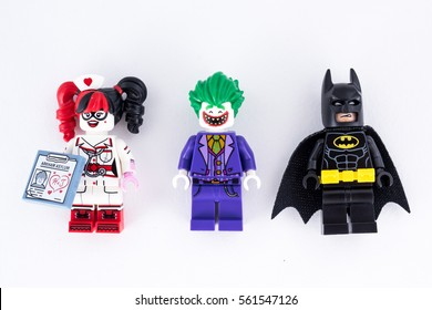 Moscow, Russia - JANUARY 21, 2017: THE LEGO BATMAN MOVIE minifigures. Batman and Joker, Harley Quinn mini on white paper background.
