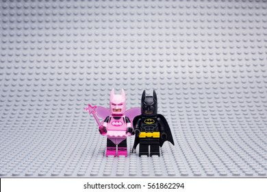 Moscow, Russia - JANUARY 21, 2017: THE LEGO BATMAN minifigures. Pink girl-Batman on Lego gray baseplate background.