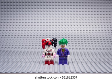 Moscow, Russia - JANUARY 21, 2017: THE LEGO BATMAN MOVIE minifigures. Joker, Harley Quinn mini on Lego gray baseplate background.