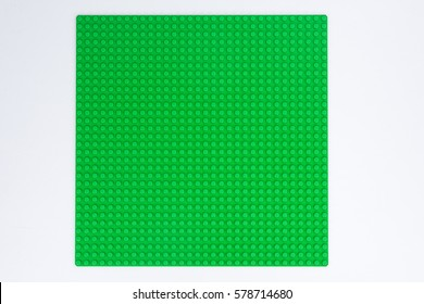Moscow, Russia - JANUARY 21, 2017: Lego Classic green baseplate. Lego is a popular toy manufactured by the Lego Group.