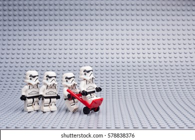 Moscow, Russia - JANUARY 21, 2017: Lego Star Wars minifigures stormtroopers on Lego gray baseplate background.