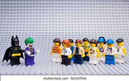 Moscow, Russia - JANUARY 22, 2017: THE LEGO BATMAN MOVIE. Batman catch Joker at yhe crowd on Lego gray baseplate background.