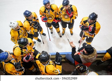 """Moscow, Russia - January, 22, 2017: Amateur hockey league LHL-77. Game between hockey team """"New Jersey 53"""" and hockey team """"Grizzly-2"""". Coach talking with team while timeout"""