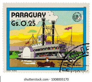 """Moscow, Russia - January 22, 2018: A stamp printed in Paraguay shows old Mississippi steamboat - a scene from Adventures of Tom Sawyer by Mark Twain, series """"International Year of Youth"""", circa 1985"""