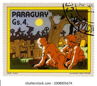 """Moscow, Russia - January 22, 2018: A stamp printed in Paraguay shows Tom Sawyer and Huck Finn at the cemetery, Adventures of Tom Sawyer by Mark Twain, series """"International Year of Youth"""", circa 1985"""