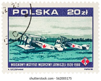 MOSCOW, RUSSIA - January 23, 2017: A stamp printed in Poland shows two old ambulance airplanes (1928), devoted to the 60th Anniversary of the Military Institute for Air Medicine, circa 1988