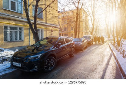 MOSCOW, RUSSIA - JANUARY 24, 2019: Three elderly women pensioner walking down the street in the Moscow courtyard in the winter in the light