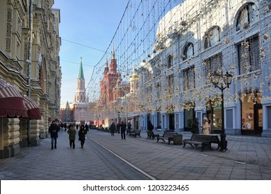 MOSCOW, RUSSIA - January 25, 2018 Walking Under Garlands at Nikolskaya. View from a corner of GUM building on Nikolskaya street decorated with garlands illuminating pedestrian street even in daylight.