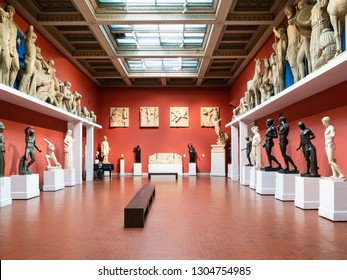 MOSCOW, RUSSIA - JANUARY 25, 2019: caretaker and replicas of ancient Greek and Roman statues in Pushkin State Museum of Fine Arts. Pushkin Museum is the largest museum of European art in Moscow