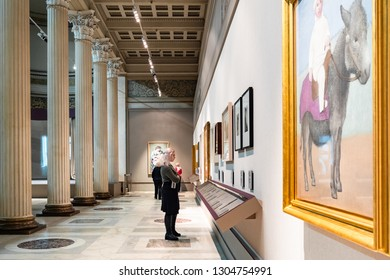 MOSCOW, RUSSIA - JANUARY 25, 2019: visitors view pictures in White Hall of Pushkin State Museum of Fine Arts at Vohonka street. Pushkin Museum is the largest museum of European art in Moscow