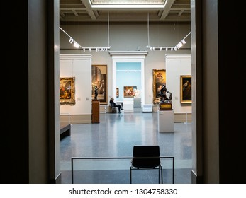 MOSCOW, RUSSIA - JANUARY 25, 2019: caretaker and rooms of main exhibition in Pushkin State Museum of Fine Arts. Pushkin Museum is the largest museum of European art in Moscow
