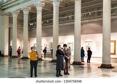 MOSCOW, RUSSIA - JANUARY 25, 2019: visitors view paintings in White Hall of Pushkin State Museum of Fine Arts at Vohonka street. Pushkin Museum is the largest museum of European art in Moscow