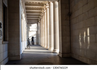MOSCOW, RUSSIA - JANUARY 25, 2019: statues in colonnade of portico of Pushkin State Museum of Fine Arts at Vohonka street. Pushkin Museum is the largest museum of European art in Moscow