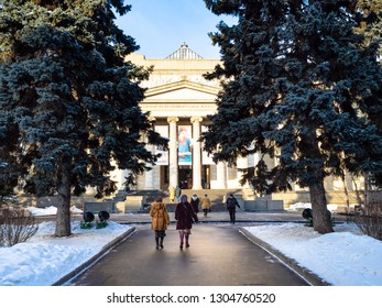 MOSCOW, RUSSIA - JANUARY 25, 2019: visitors go to entrance to Pushkin State Museum of Fine Arts at Vohonka street in winter day. Pushkin Museum is the largest museum of European art in Moscow