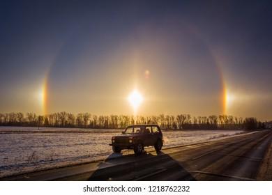 Moscow, Russia - January 26, 2014: Russian off-road car Lada Niva and Halo - optical phenomenon