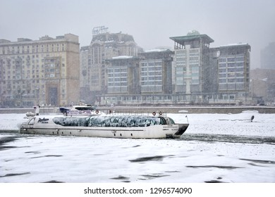 "MOSCOW, RUSSIA - January 26, 2019 View from the embankment of Tarasa Shevchenko on the ice-breaker cruiser ""Ferdinand"" of the Radisson Royal Flotilla on the River Moskva in the heavy snowfall."