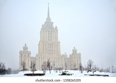 "MOSCOW, RUSSIA - January 26, 2019 View from a small park at Tarasa Shevchenko Embankment on the former hotel ""Ukraina"" (in present time hotel ""Radisson Royal"") in heavy snowfall."