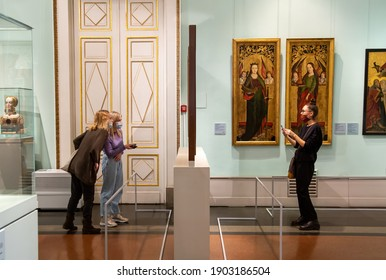 Moscow, Russia - January 26, 2021: People wearing protection mask in Pushkin Museum of Fine Arts is largest museum of Europe art in Moscow