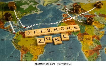 MOSCOW, RUSSIA. January 27, 2018. Golden money with white lines leading to famous offshore zones, world map on the background. Offshore zones concept.