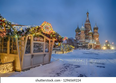 MOSCOW, RUSSIA - January 27, 2019 GUM-Market Booth and St. Basil's Cathedral in Morning Twilight after heavy snowfall.