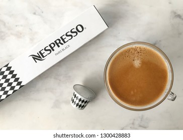 MOSCOW, RUSSIA - JANUARY 27, 2019: Limited Collection Nespresso Variations Paris Coffee Capsule and Box on Light Background. Coffee Blend Paris Black. Nespresso is Worldwide Company of Coffee Product