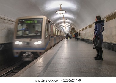MOSCOW RUSSIA JANUARY 3 2019 underground train arriving at Ploshchad revolyutsii metro station in Moscow Russia - using low shutter speed shot for motion blur