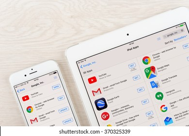 Moscow, Russia - January 30, 2016: Google applications on iphone and ipad display. Google is an American multinational corporation specializing in Internet related services and products.