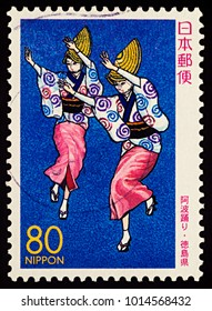 """Moscow, Russia - January 31, 2018: A stamp printed in Japan shows two Japanese dancing women, Awa Odori Dancers, series """"Prefectural Stamps - Tokushima"""", circa 2000"""