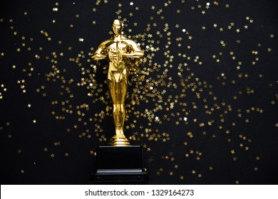 Moscow, Russia - January 31, 2019: oscar gold statue trophy on a black background, symbol of the victory of the actor in his profession. editorial