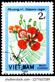 MOSCOW, RUSSIA - JANUARY 4, 2019: A stamp printed in Vietnam shows Flamboyant (Delonix regia), Blossoming Woody Plants serie, circa 1984
